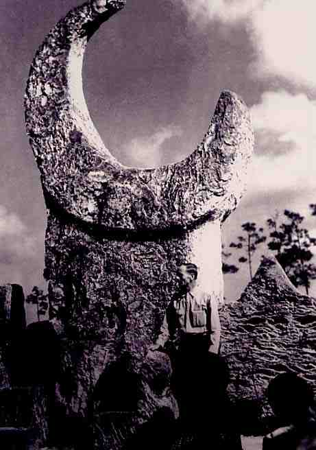 Ed Leedskalnin with His 18-Ton Moon Carving at Coral Castle.
